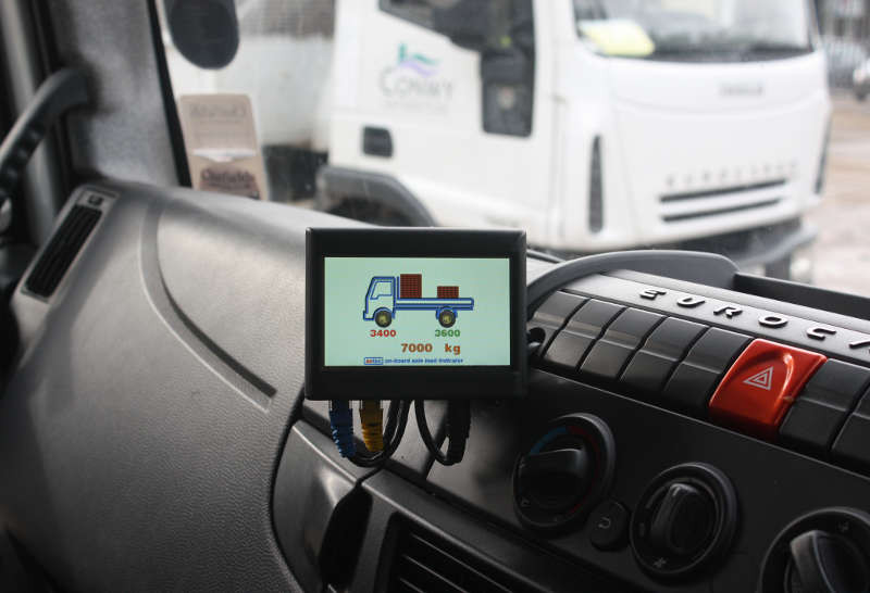 Image of an onboard system attached to a dashboard looking out to a HGV